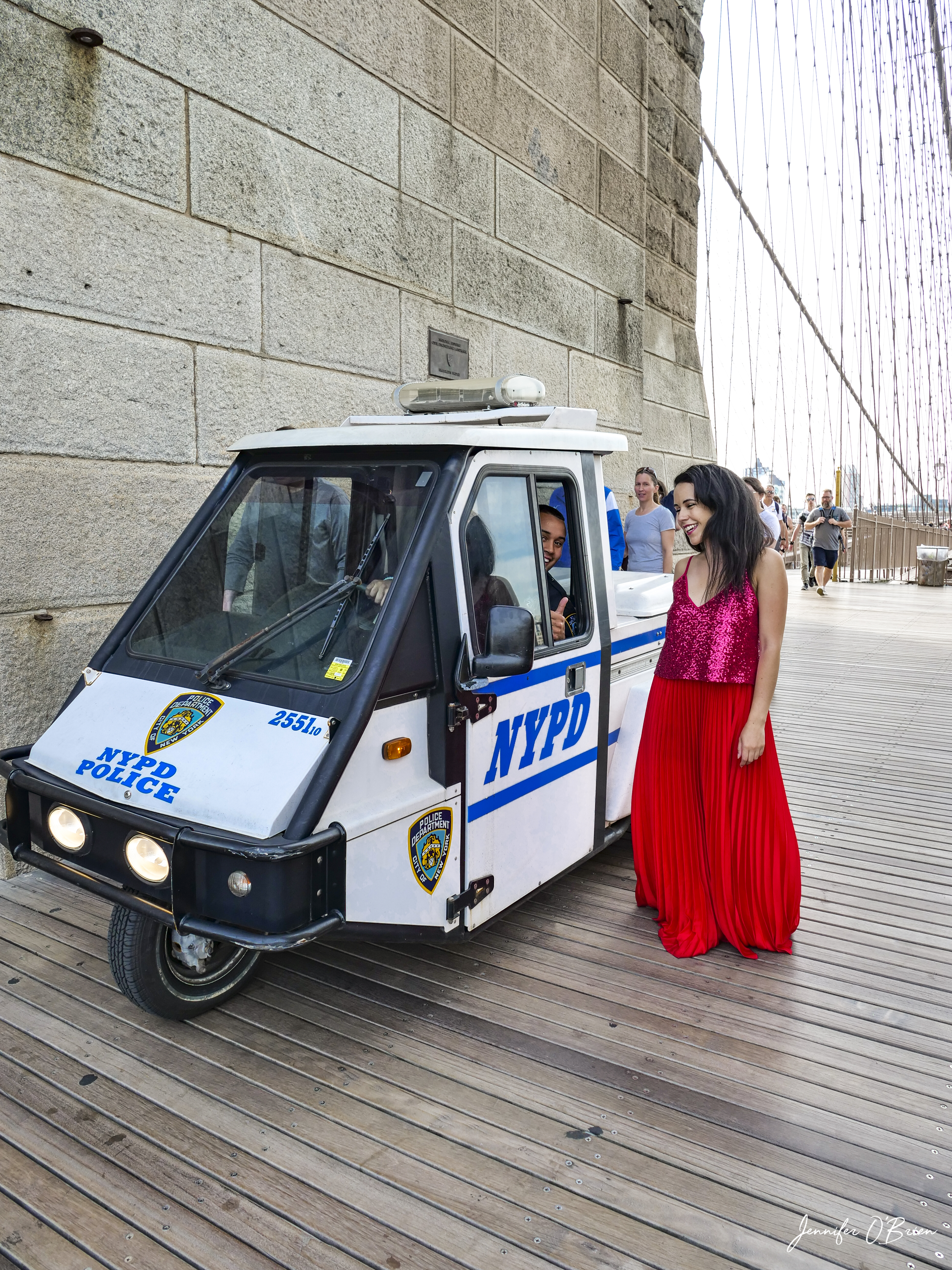 Top Instagram Photos of the Brooklyn Bridge The Travel Women Tower NYPD police smiling NYC bike mini car