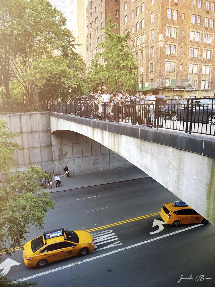 Manhattanhenge NYC tudor city 42nd street photographers on bridge
