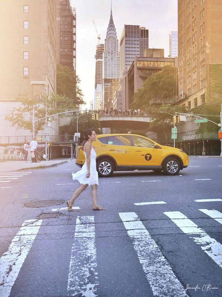 Manhattanhenge NYC tudor city 42nd street girl in white dress