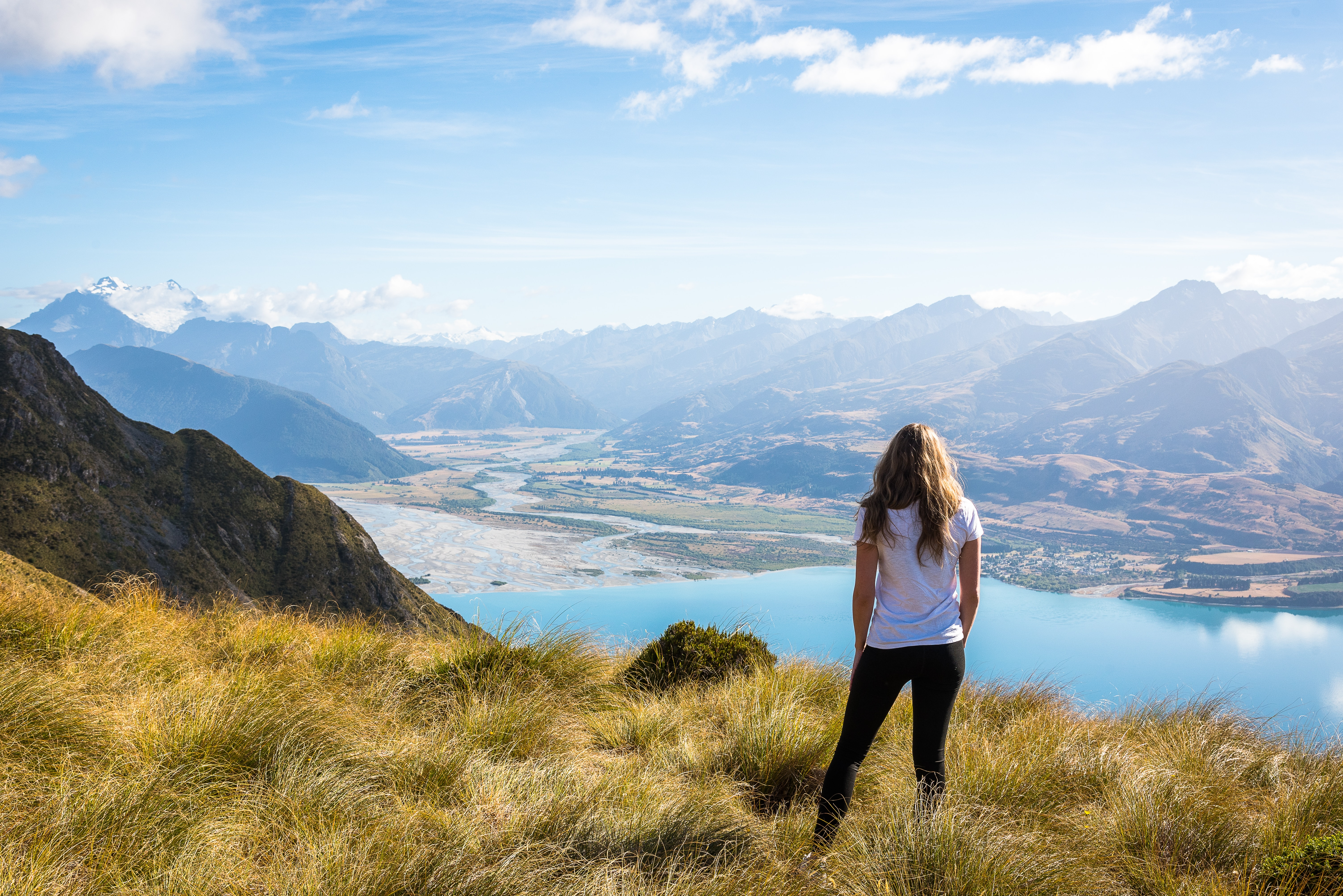 New Zealand woman overlooking mountains
