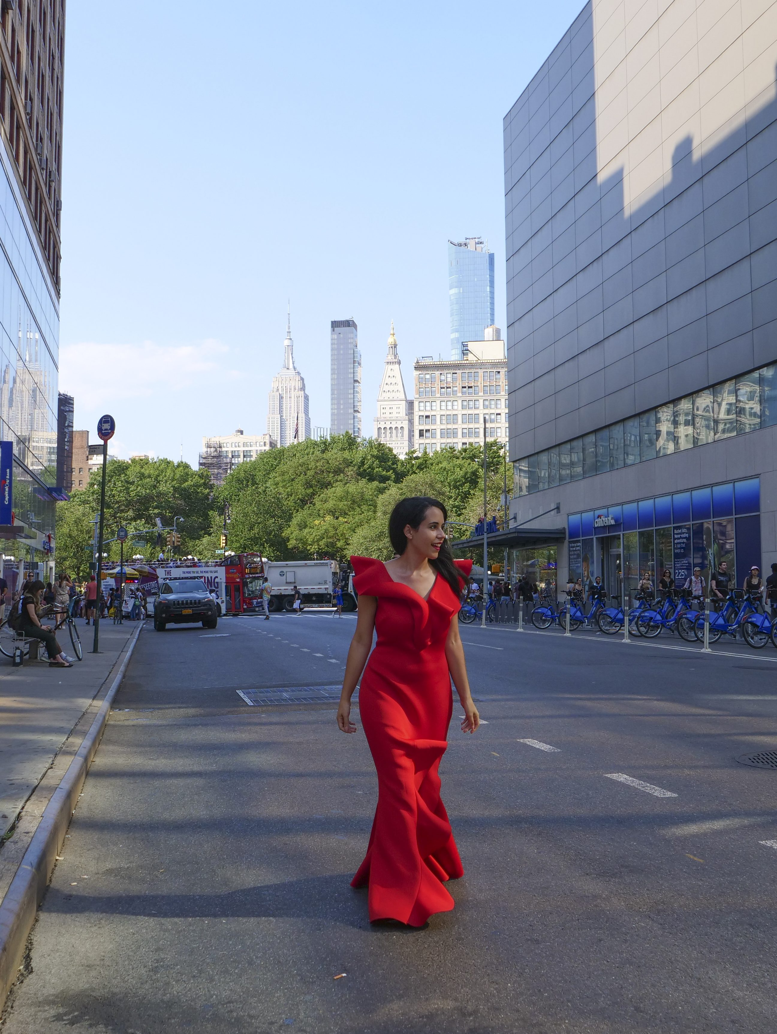 Empire State Building woman red dress union square street