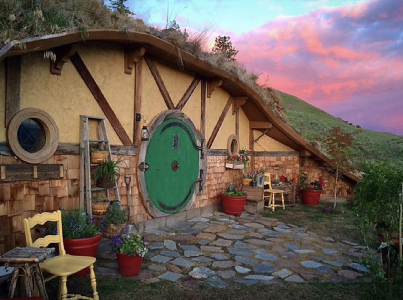 Hobbit and Lord of the Rings Airbnb homes and houses in the USA round door sunset