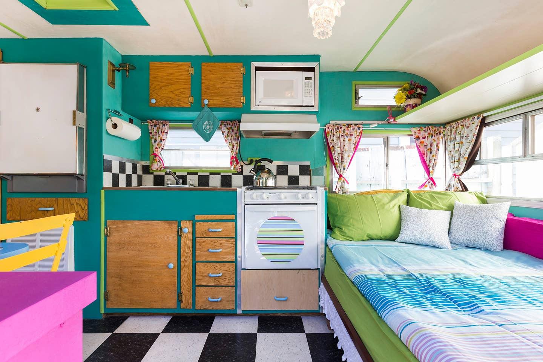 Most Unique USA Airbnbs vintage colorful caravan airstream interior bed