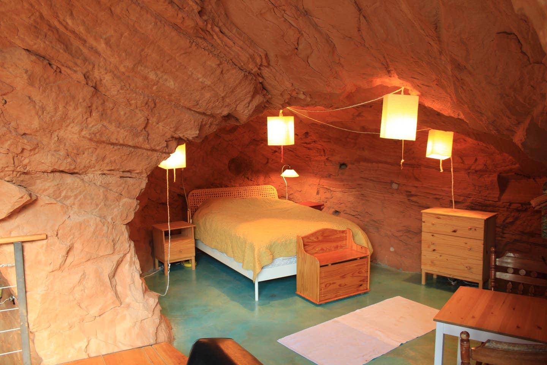 Most Unique USA Airbnbs Navajo sandstone home cave Boulder Utah bedroom