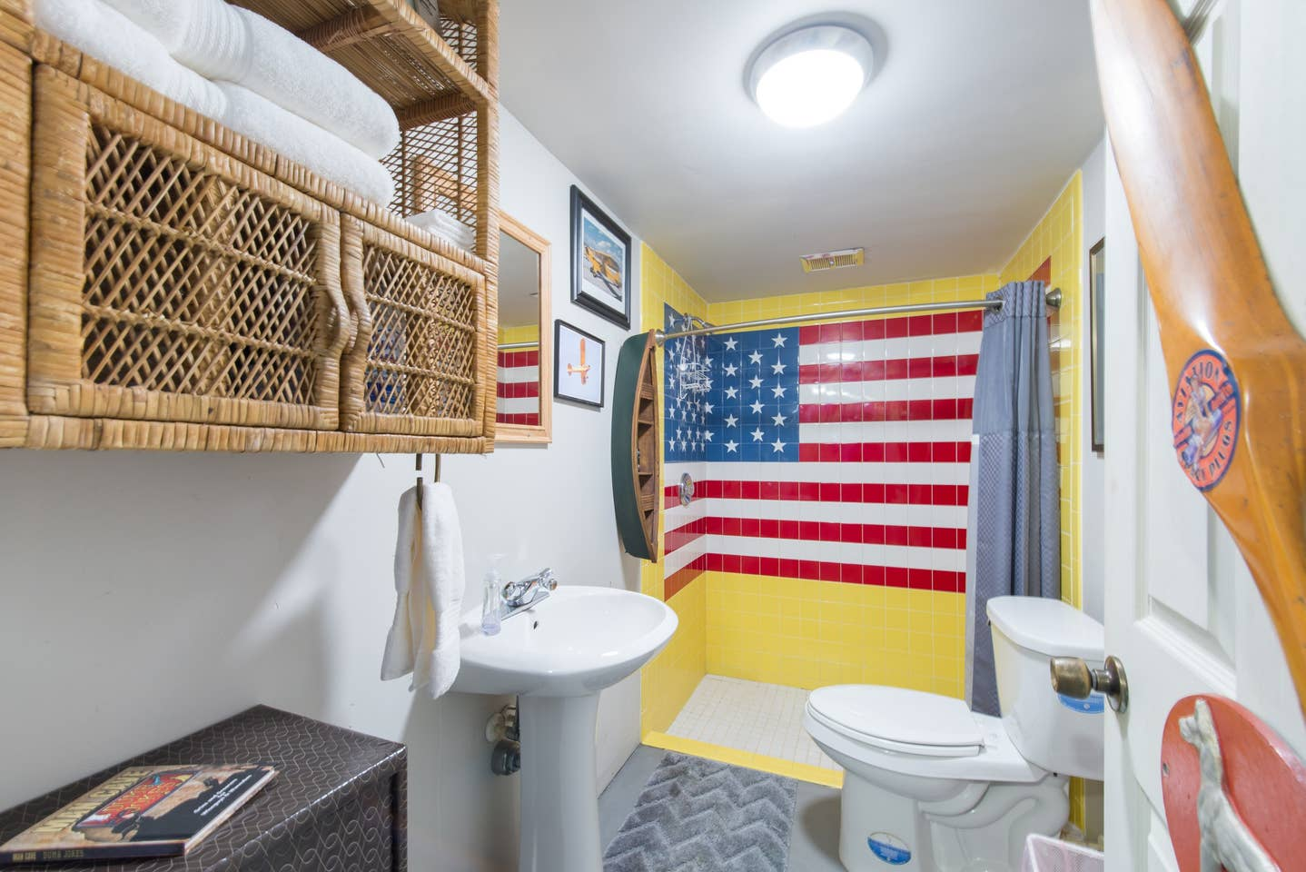 Most Unique USA Airbnbs man cave airplane hanger bathroom American Flag