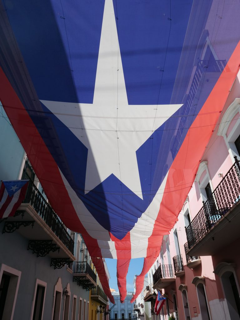 San Juan Puerto Rico secrets street with umbrellas huge Puerto Rican flag
