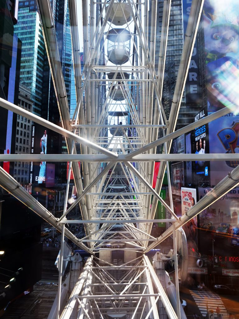 Times Square ferris wheel NYC view inside the metal spokes of the wheel