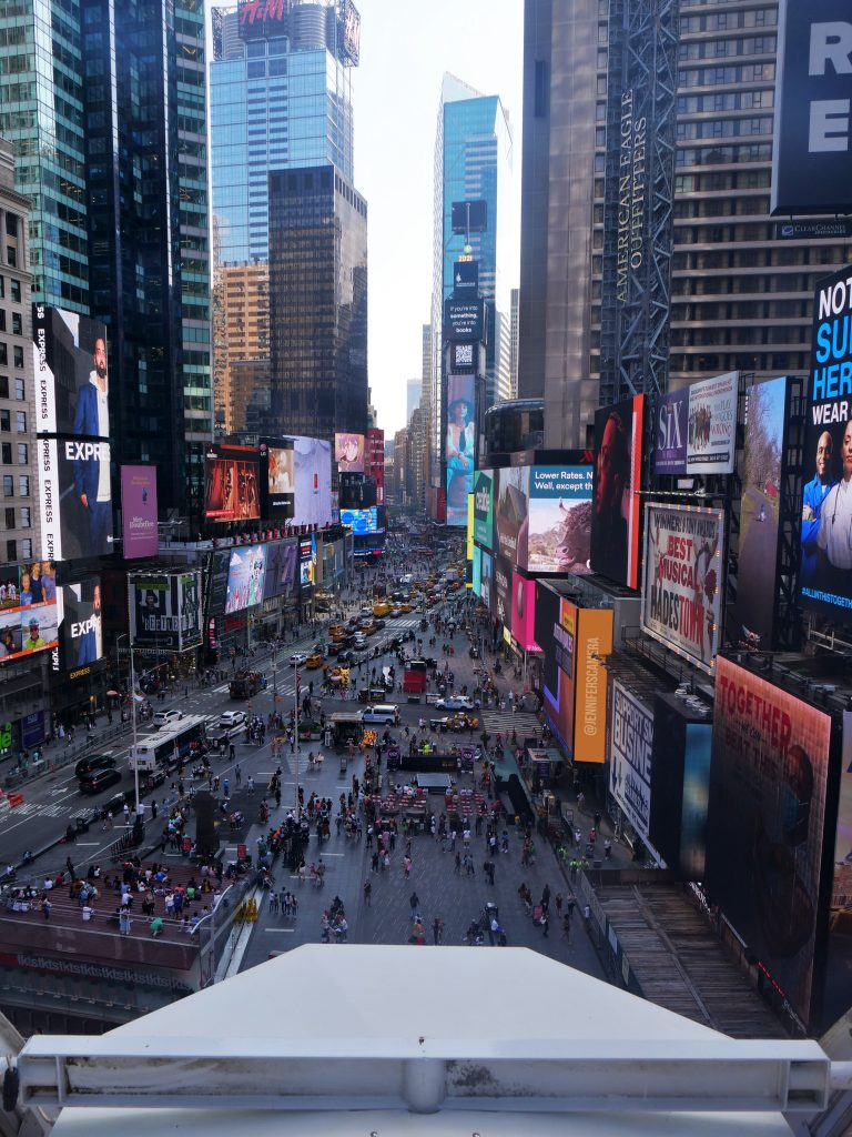 Times Square ferris wheel NYC from inside on the top views of the billboards