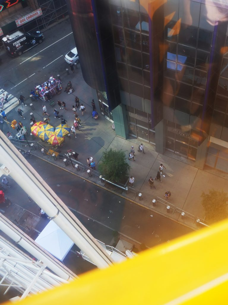 Times Square ferris wheel NYC hot dog stands view from the top
